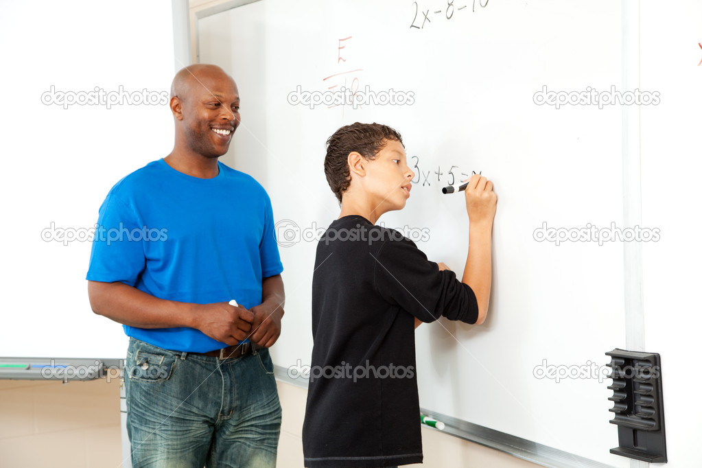African American math teacher helping a student to pre-algebra on the board. — Stock Photo #12122971