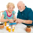 Senior Couple Sorts Medications — Stok fotoğraf