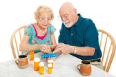 Senior Couple Sorts Medications — Stock Photo