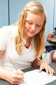 Blond Teen Girl in School — Stock Photo
