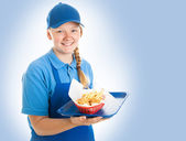 Fast Food Worker on Blue — Stock Photo