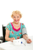 Woman Taking Her Own Blood Pressure — Stock Photo