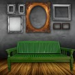 Vintage interior with chair and photo frames — Stock Photo