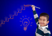 Boy drawing step up of idea for success — Stock Photo