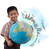 Boy holding globe for dream travel around the world — Stockfoto