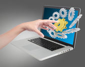 Hand pushing on a touch gears on screen — Stock Photo