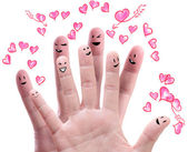 Happy group of finger faces with their love offering — Stock Photo