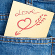 Love in pocket of jean — Stockfoto