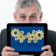 Business man showing one computer tablet with 3d gear for collab — Stock Photo #12054916