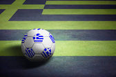 Flag of Greece with soccer ball over grass background - Euro 201 — Stock Photo