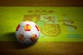 Flag of Spain with soccer ball over grass background - Euro 2012 — Stock Photo