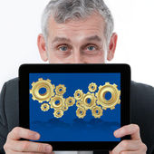 Business man showing one computer tablet with 3d gear for collab — Stock Photo