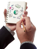 Business man writing collaboration diagram on book — Stock Photo