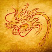 Dragon on grange old paper, 2012 year of dragon — Stock Photo