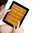 Woman toch application shelf of ebook on modle tablet pc — Stock Photo