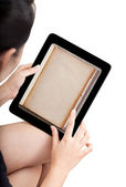 Woman toch application shelf of ebook on modle tablet pc — Stockfoto