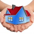 The House in the hands as a symbol of the real estate business — Stock Photo