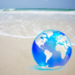 Royalty-Free Stock Photo: Crystal globe over sand and  sea
