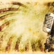 Stock Photo: Grunge music background with old microphone