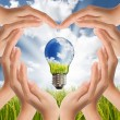 Hands saving , Global Concept of Green Energy Solutions With Lig — Stock Photo