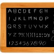 Hand writing alphabet on wooden black board frame — Stock Photo #12303945