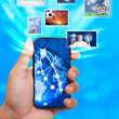 Touch screen mobile phone with streaming images — Stock Photo