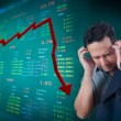Business man stress about falling stock market - Stock Photo