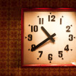 Foto Stock: Old clock on retro background