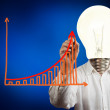 Businessman with lamp-head drawing growth graph — Stock Photo