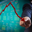 Business man point to falling graph of stock market — Stock Photo