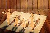 Warmth family concept, make for cut out of paper on wood texture — Stock Photo