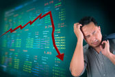 Business man stress about falling stock market — Stock Photo