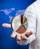 Affärsman som innehar tillväxt diagram med världen karta bakgrund — Stockfoto