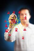 Obchodní muž postavil sociální síť — Stock fotografie