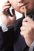 Business man with mobile phone to process his business — Stock Photo