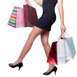 Beautiful woman with shopping bags for sale promotions — Stock Photo