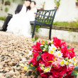 Stock Photo: Flowers with bride and groom