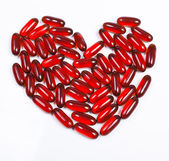 Heart made of red capsule — Stock Photo