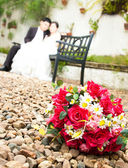 Flowers with bride and groom — Stock Photo