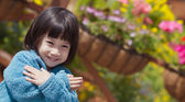 Cute asian girl with spring flowers — Stock Photo