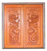 Chinese dragon wooden door — Stock Photo