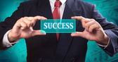 Business man holding button of success — Stock Photo