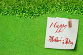 Happy mothers day on green grass — Stock Photo