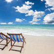 Beach chair on white sand beach - Stock Photo
