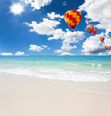 Colorful hot air balloon on the sea with blue sky — Stock Photo