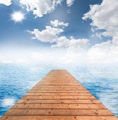 Wooden bridge with blue sky — Stock Photo