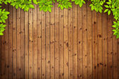 Old grunge wood texture with leaves — Stock Photo