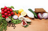 Healthy food. Fresh vegetables and fruits on a wooden table. — Stock Photo