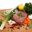 Raw meat, vegetables and spices isolated on a wooden table. — Stock Photo
