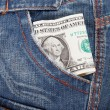 Dollar bill in his pocket jeans. — Stock Photo